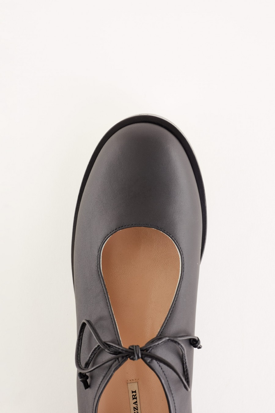 leather shoes with teardrop neckline