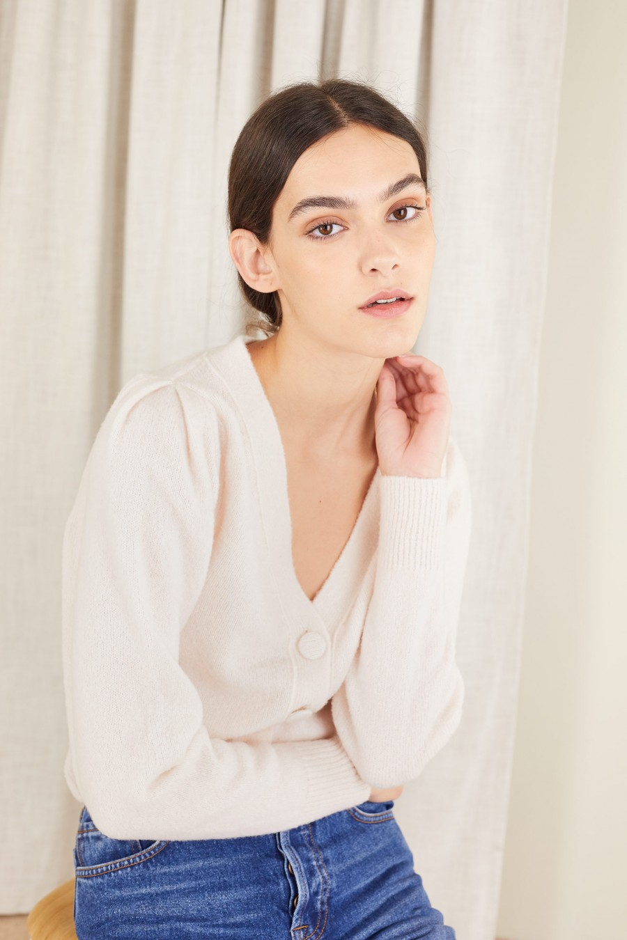 white sweater with V-neck