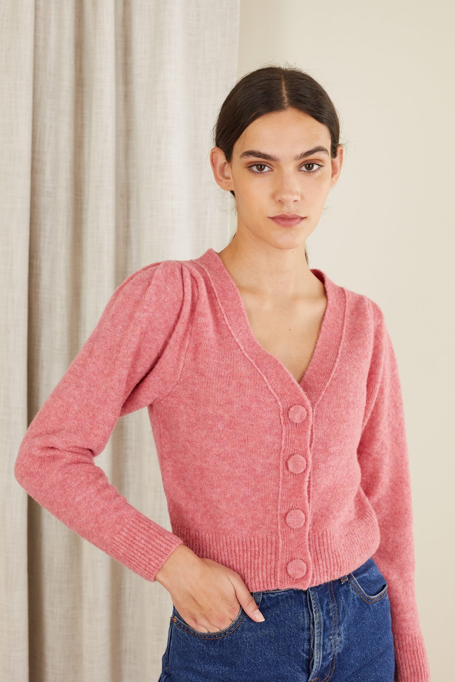 pink sweater with covered buttons