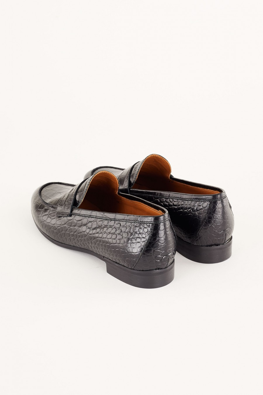 black crocodile-print loafers
