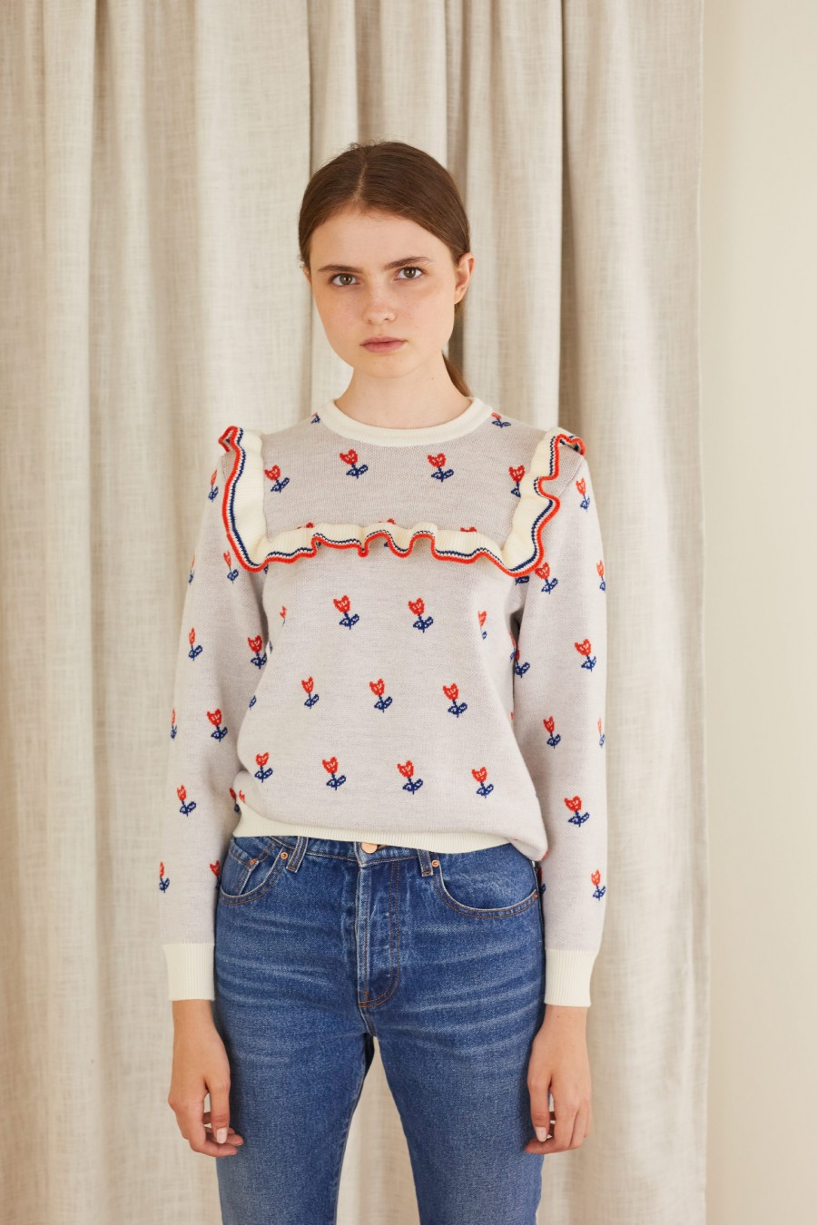 Jumper with ruffle and jacquard flowers