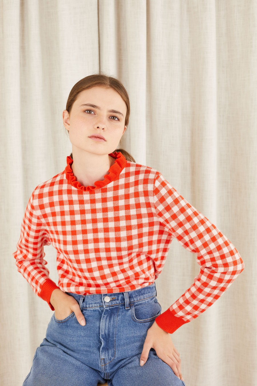 red checked jumper with pie crust collar