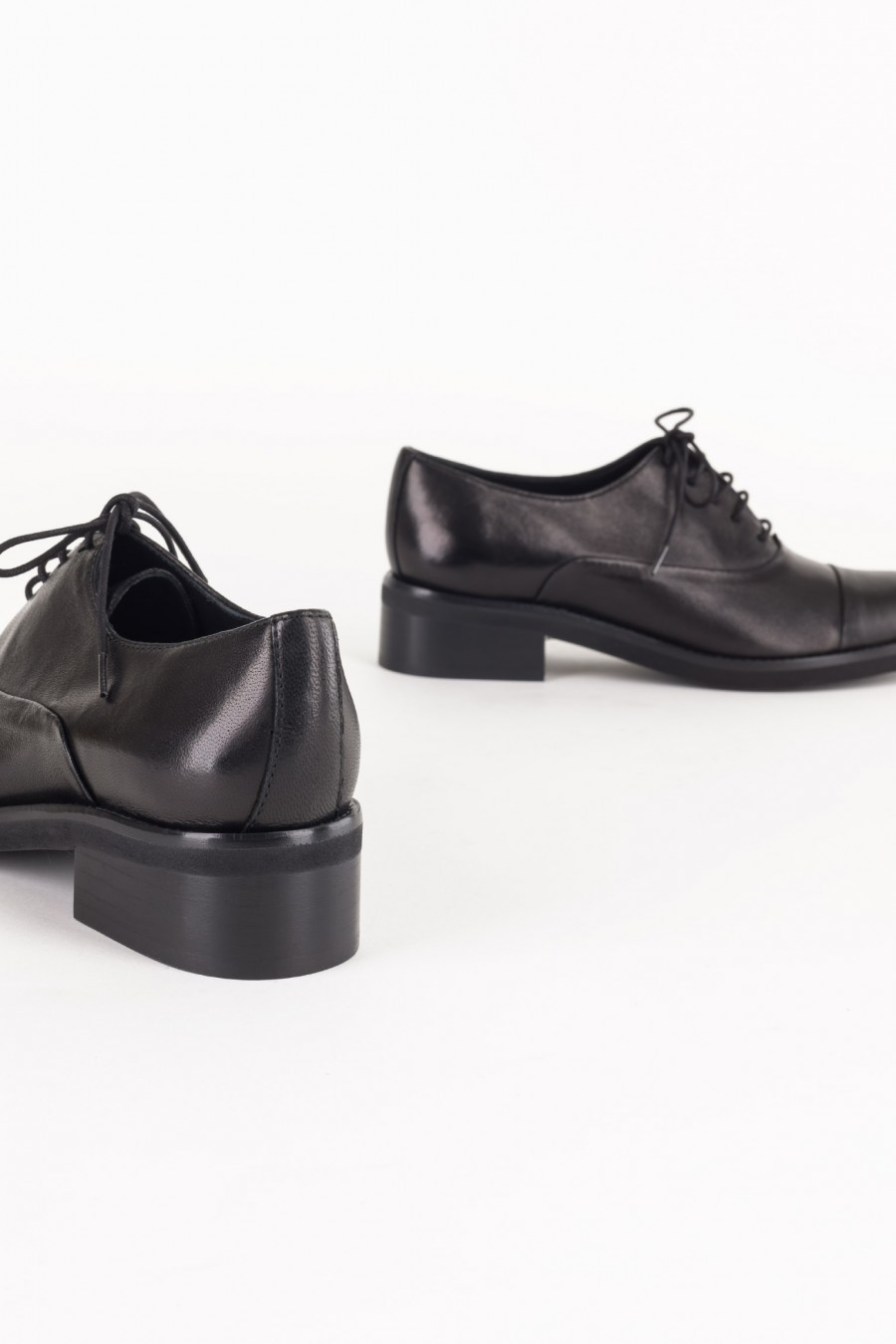 Laced black derby shoes