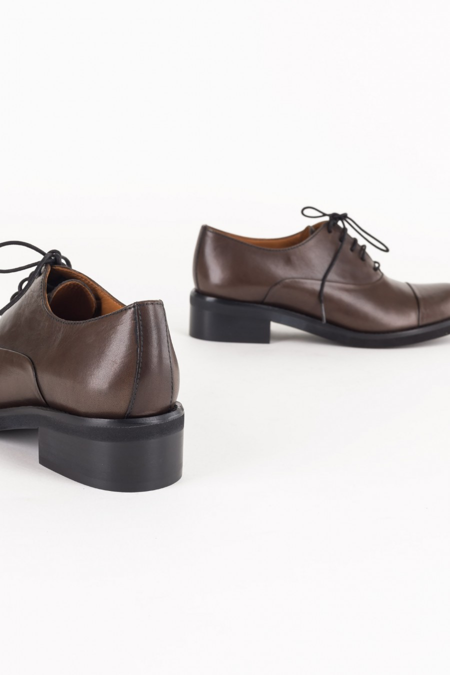 Laced brown shoes