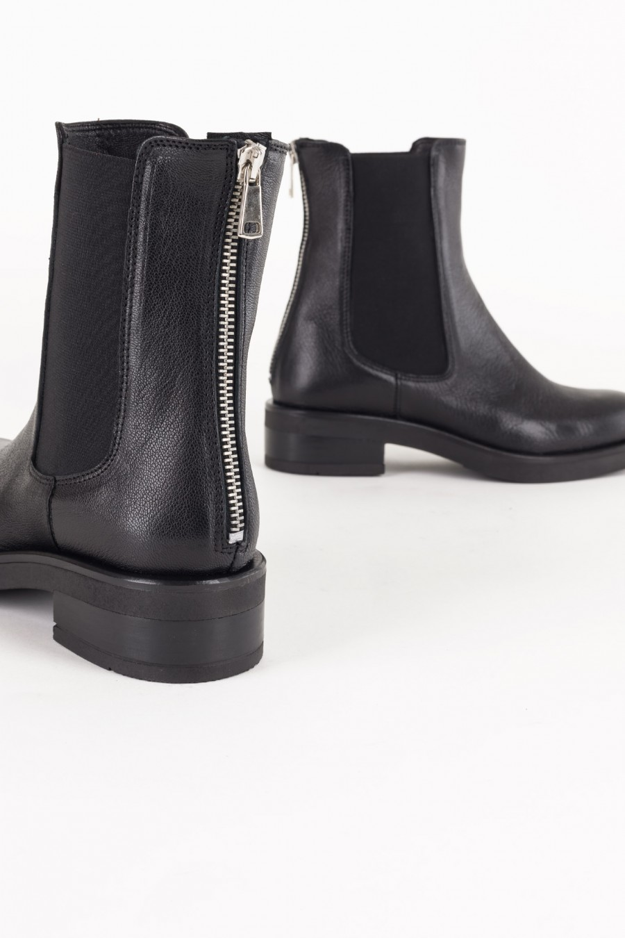 Boots with back zipper