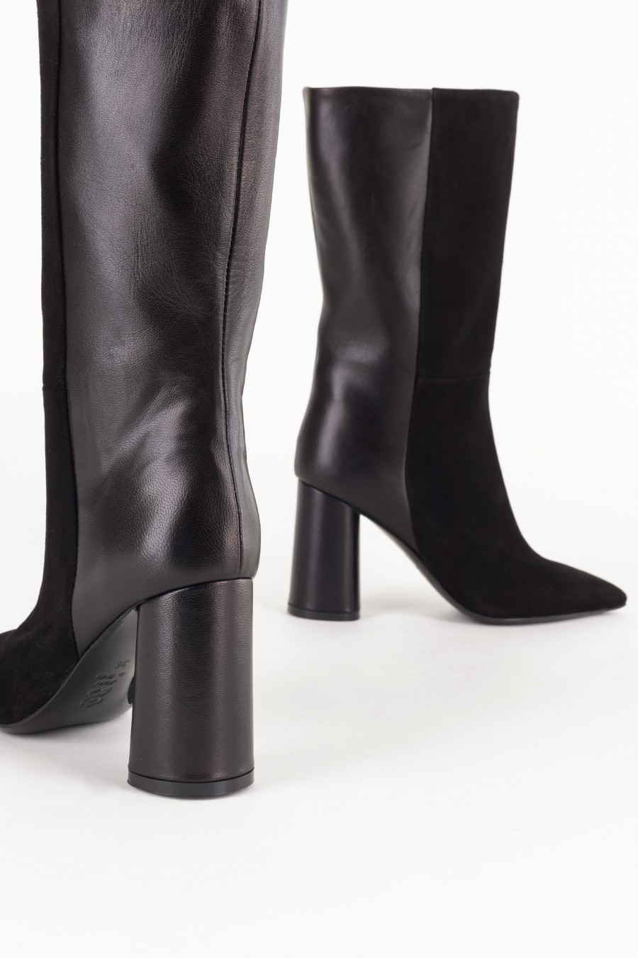 Pointy black boots