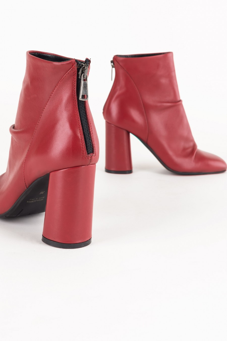 Red boots with rounded heels