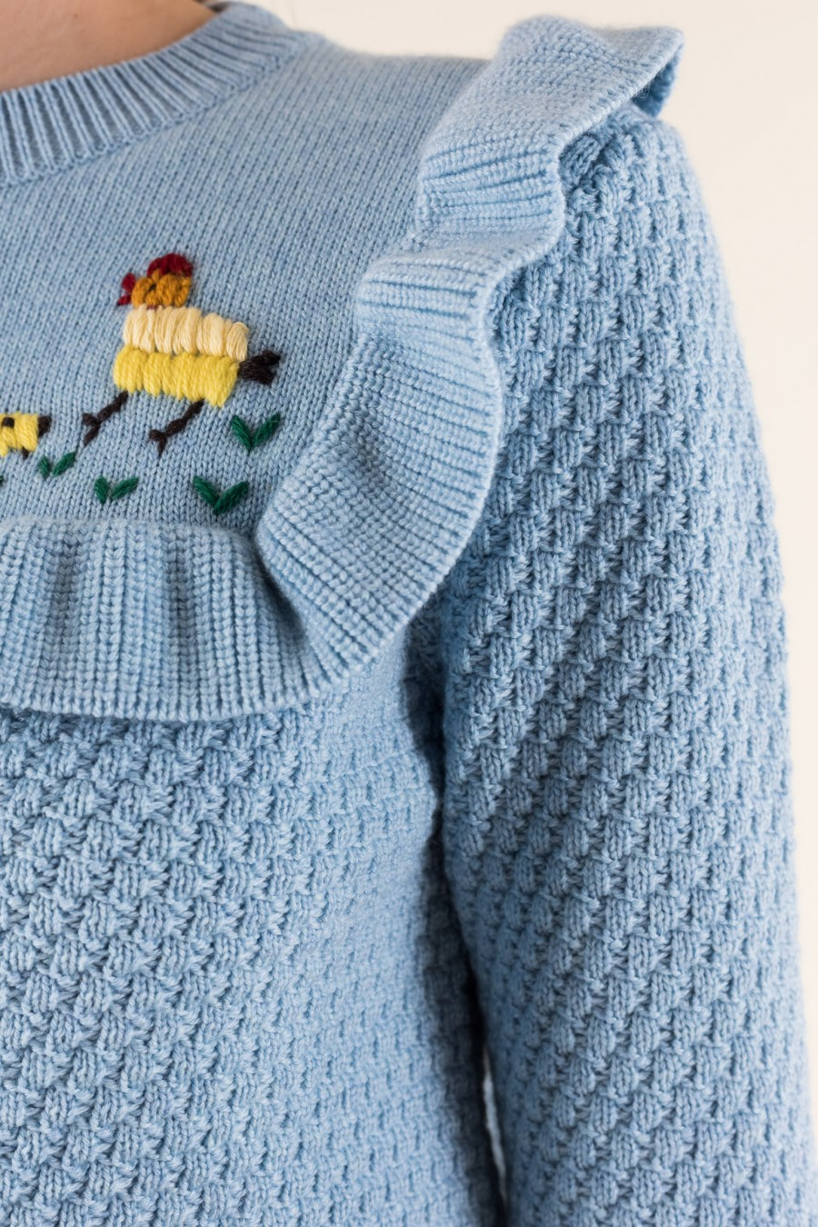 Pale blue sweater with ruffles