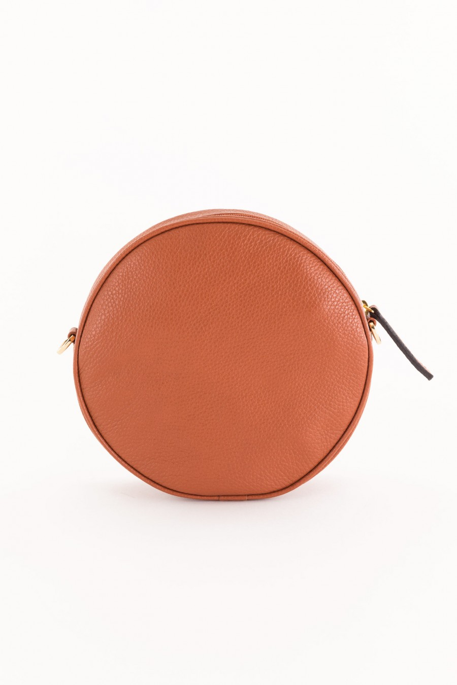 round leather-colored bag with shoulder strap
