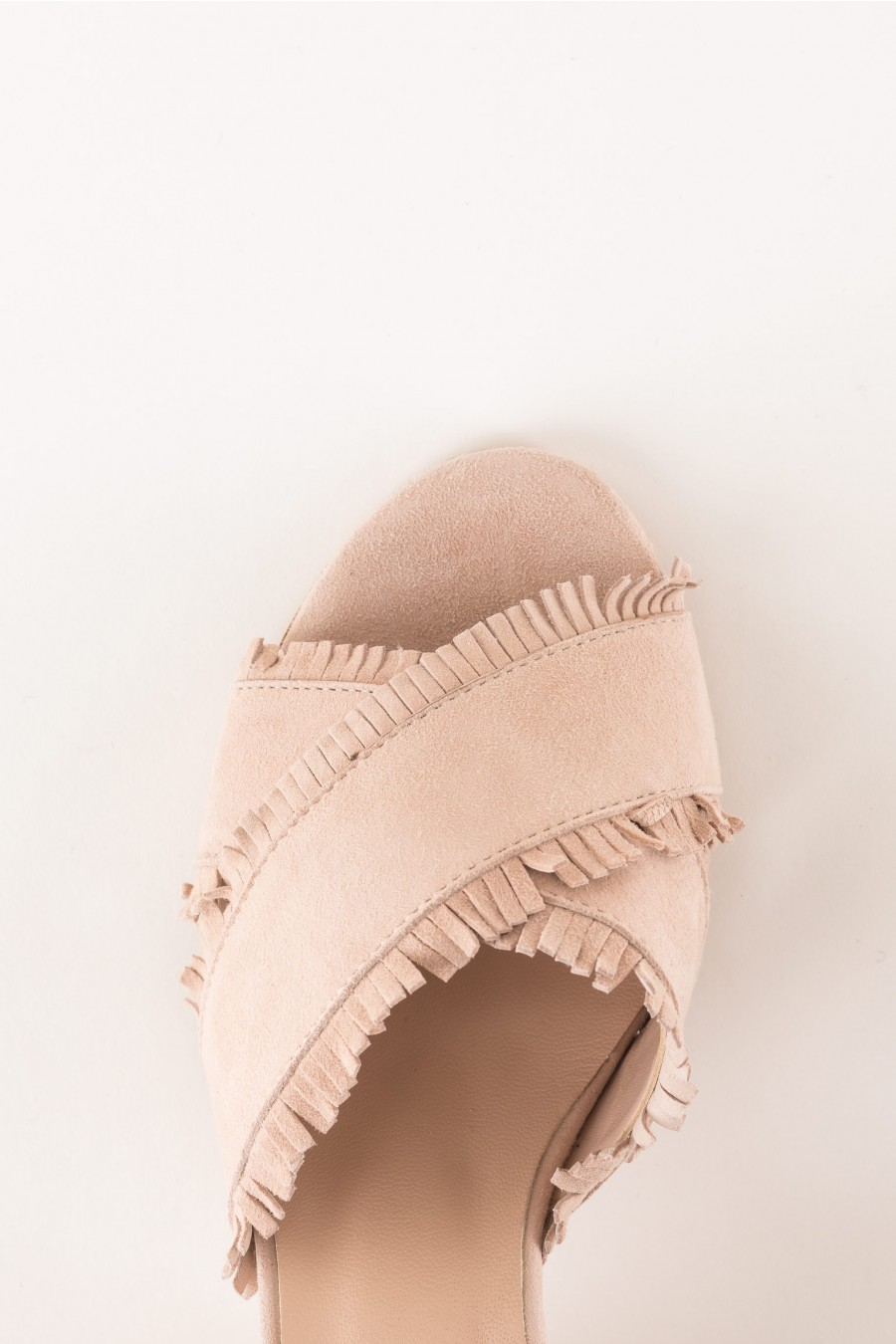 powder sandal with cross strap and fringes