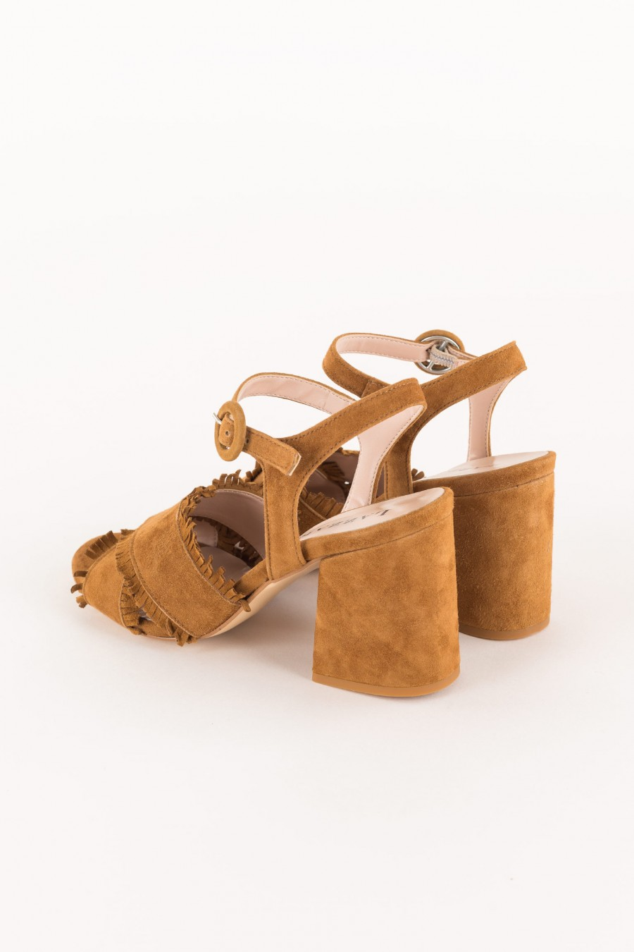 leather-colored sandal with cross strap and fringes