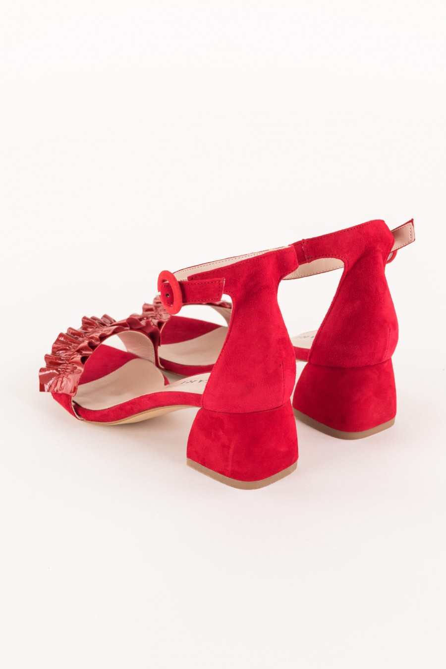 red sandal with ruffle on the strap