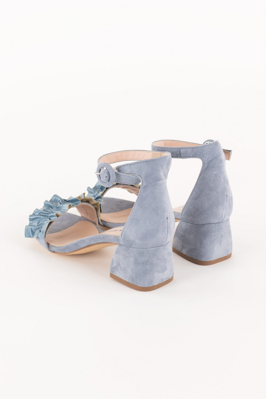 light blue sandal with patent leather ruffle on the strap