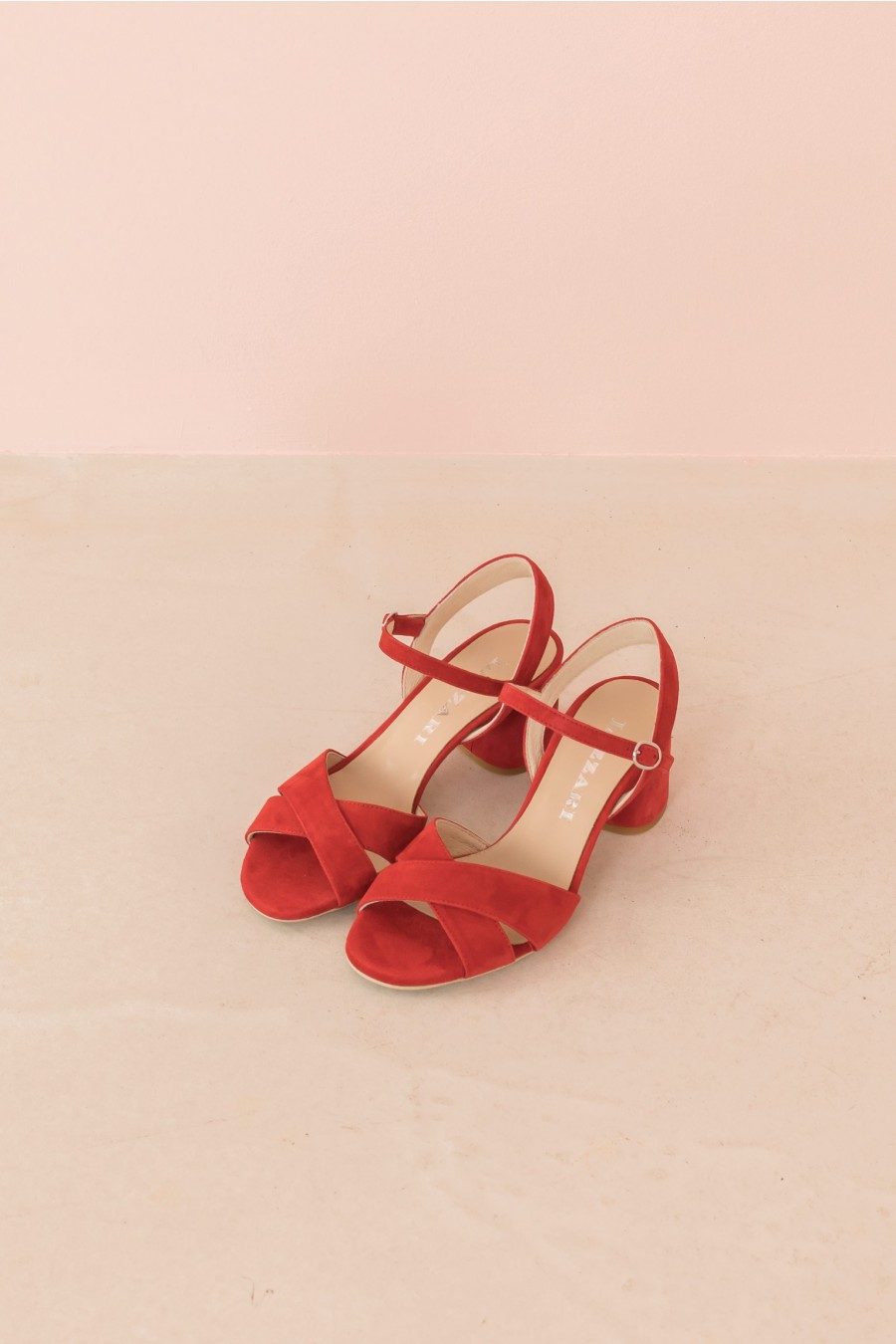 red sandal with shoestrap