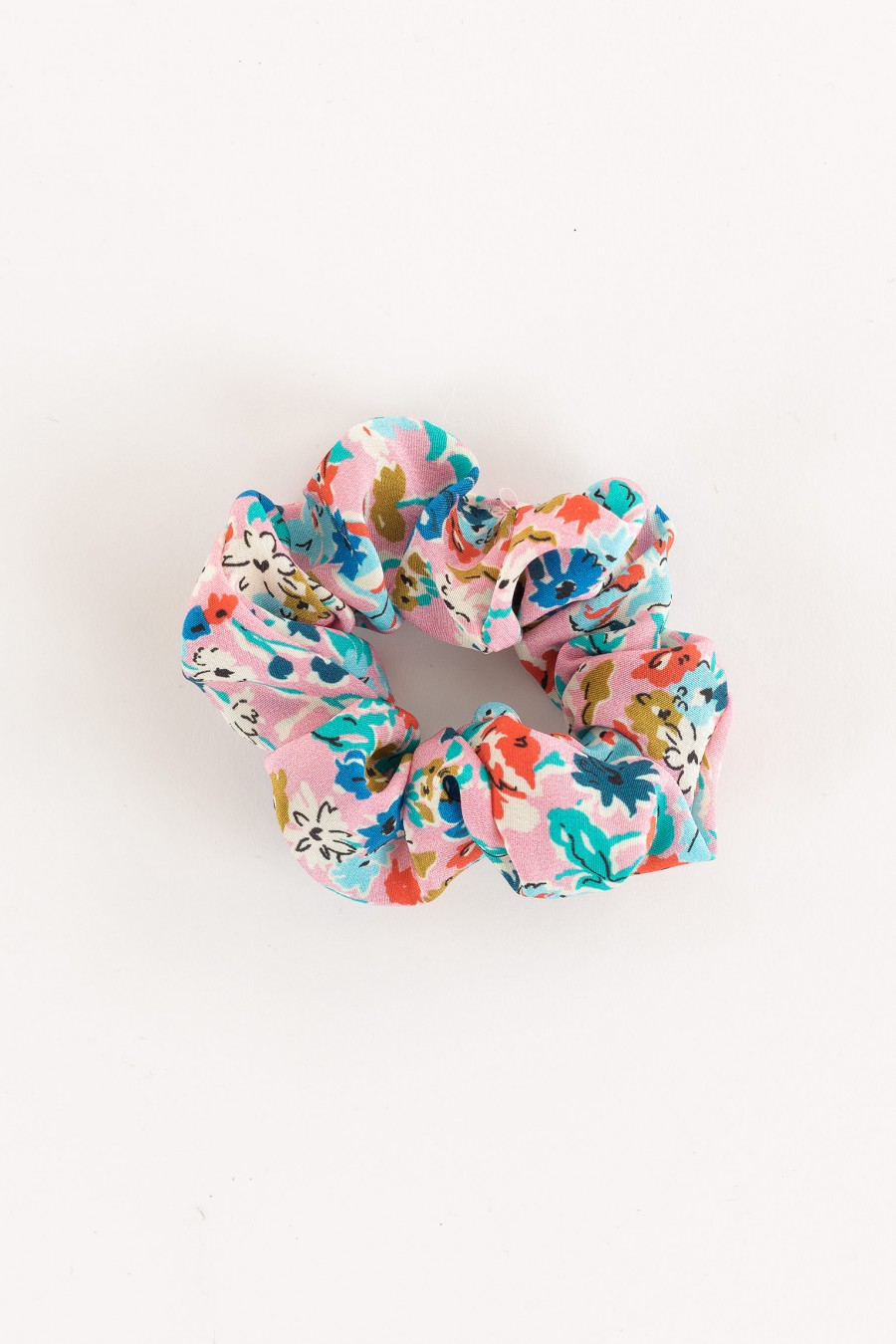 scrunchie flowers on a pink background