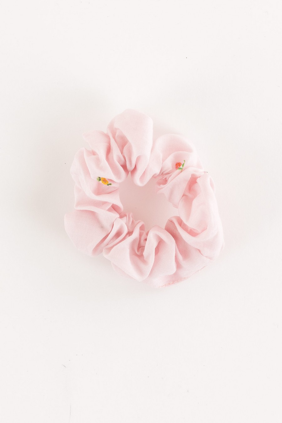 scrunchie with little flowers on a pink background