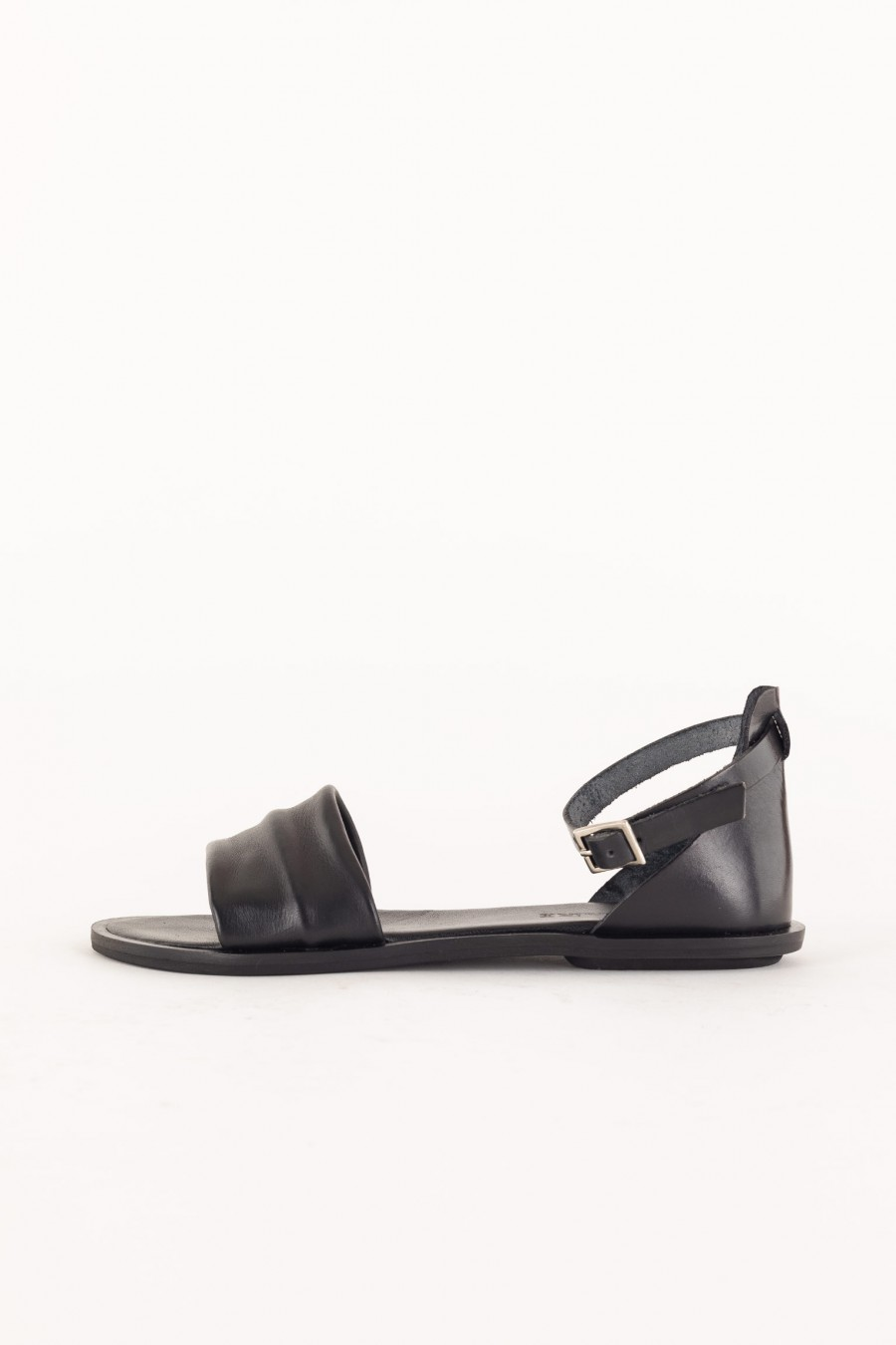 flat black sandal with band and ankle strap