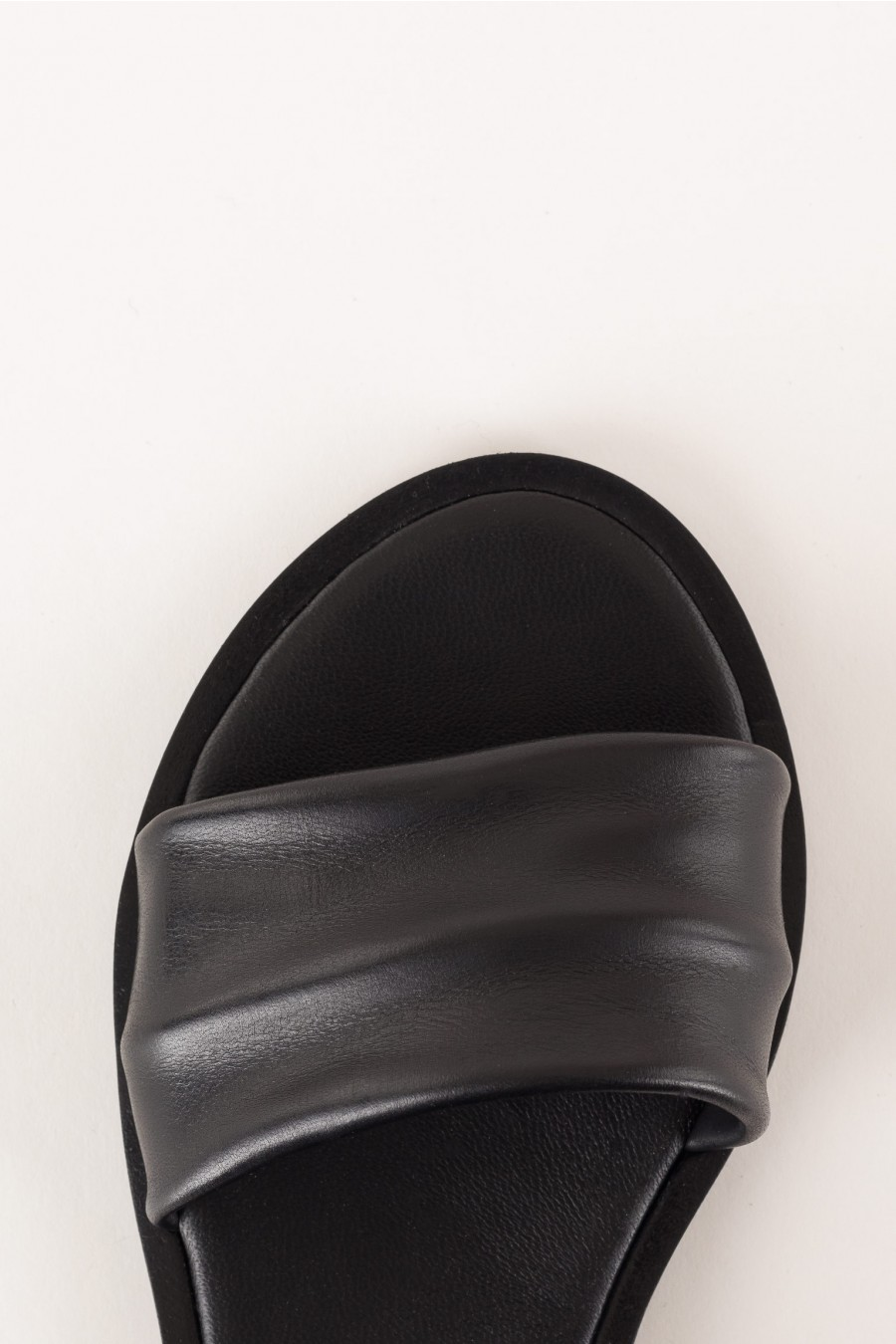 black sandal with pleat on the strap