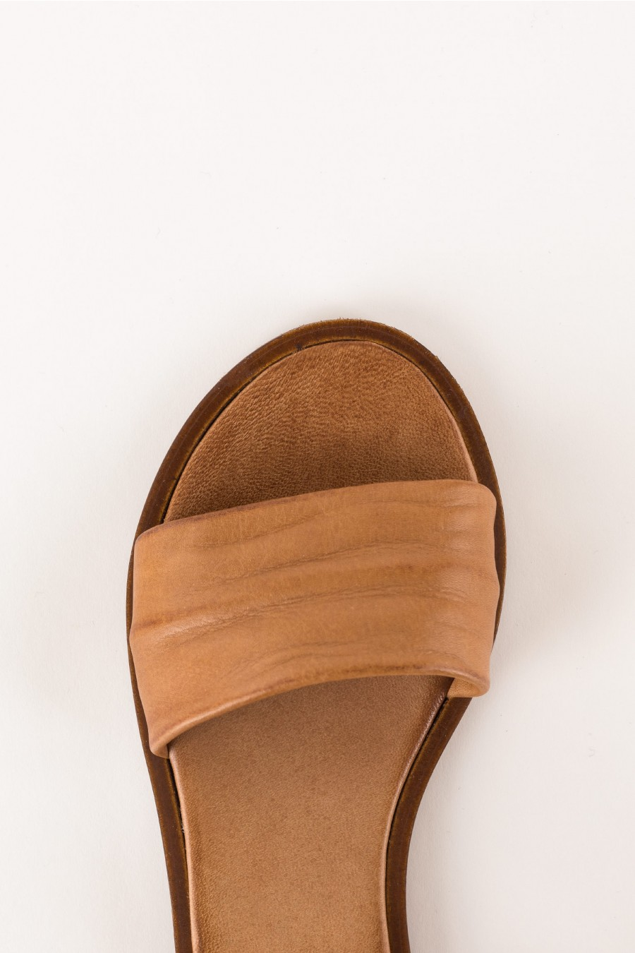 flat leather-colored sandal