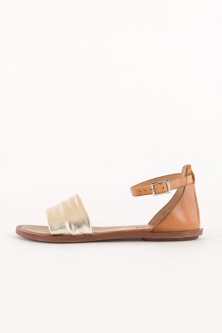 flat sandal with ankle strap and platinum band