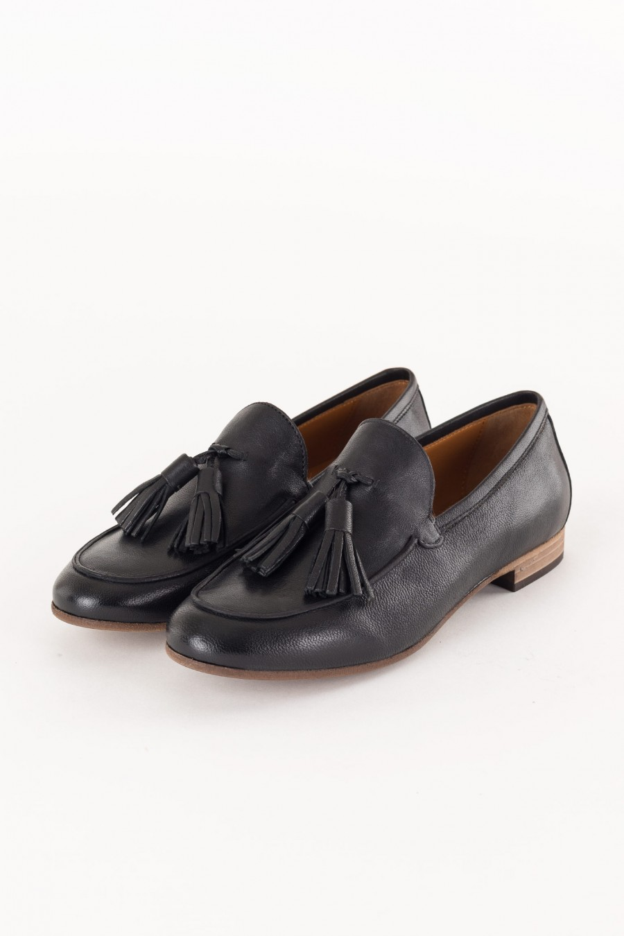 black loafer with tassels