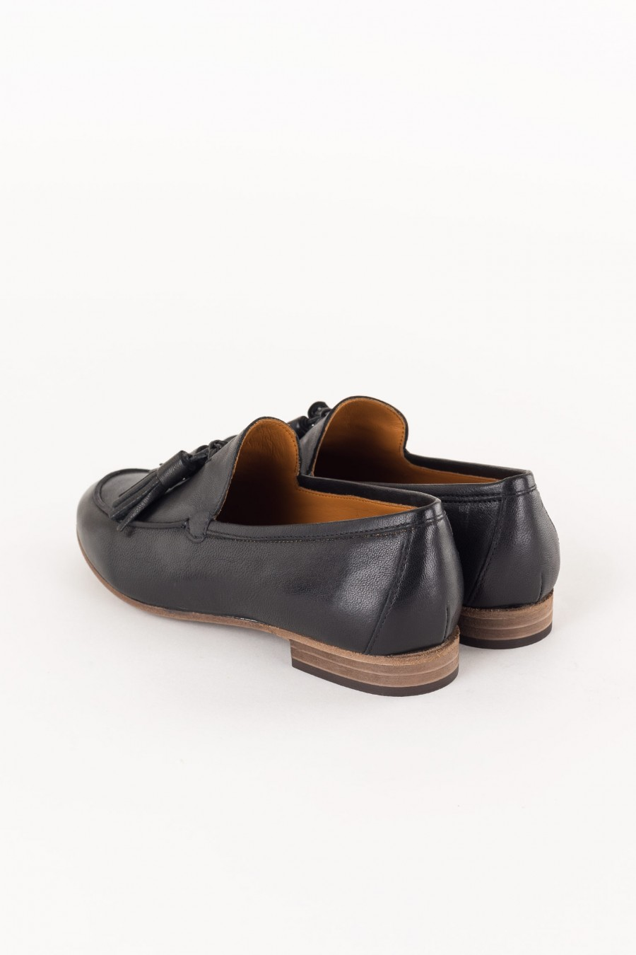 black leather loafer with tassels