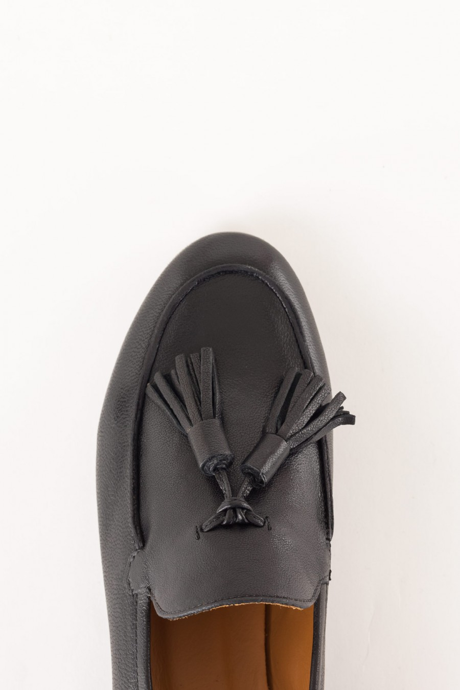 black shoe with tassels
