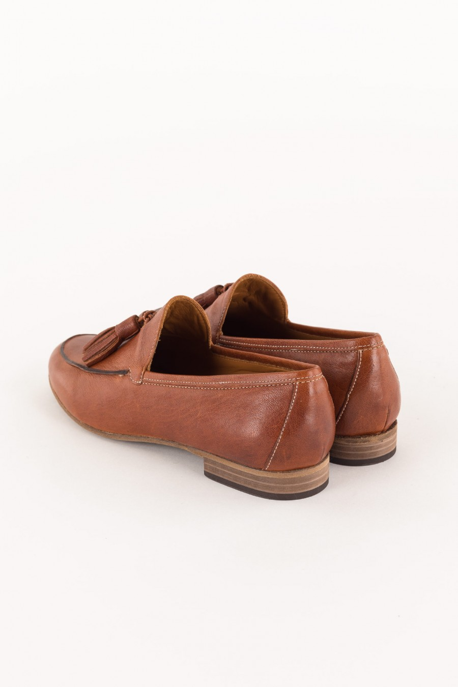 leather brick colored loafer with tassels