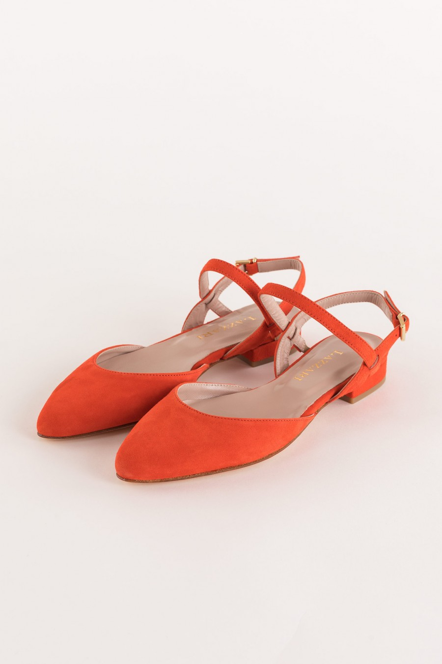 flat coral-colored pointed shoe