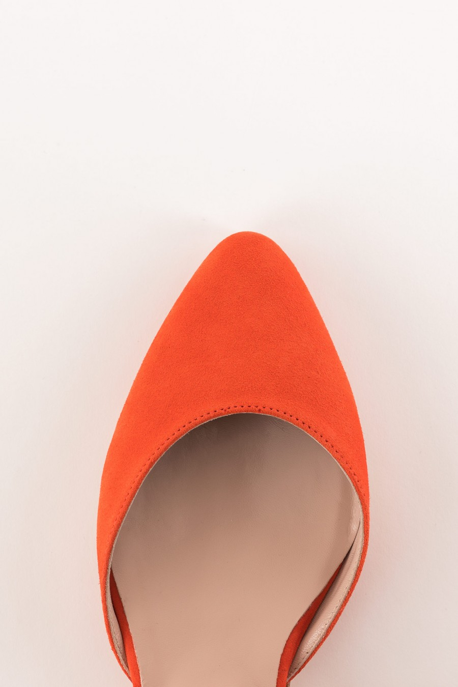 coral-colored suede pointed ballerina