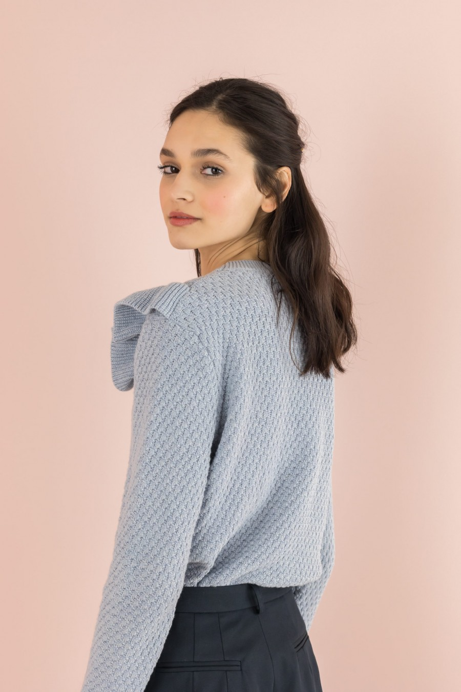sky-colored sweater