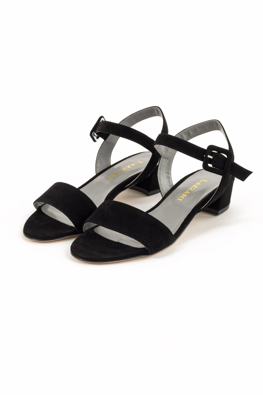 Sandal with covered buckle