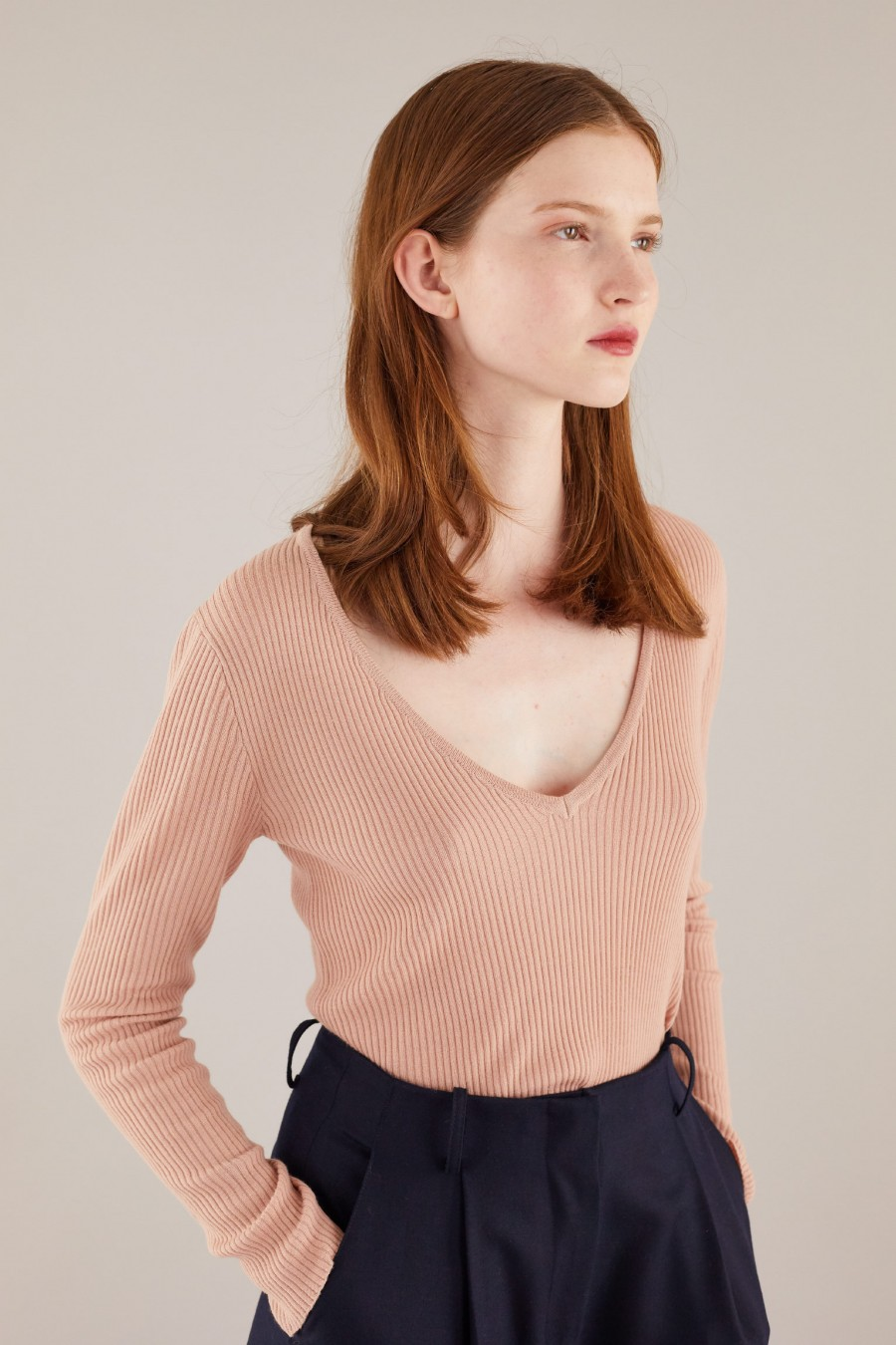 Thin sweater with deep V neckline