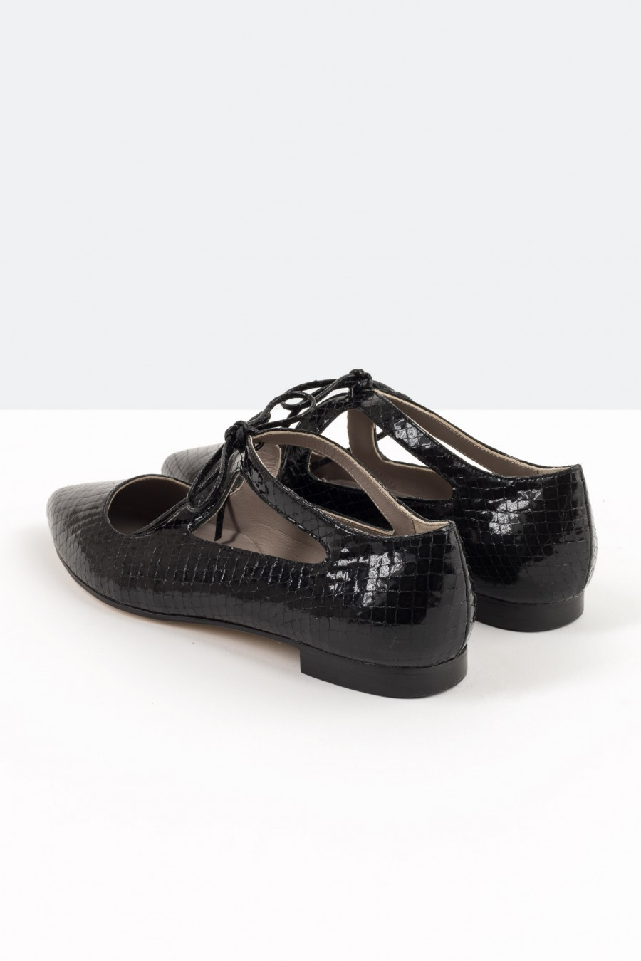 Pointed toe black patent flats