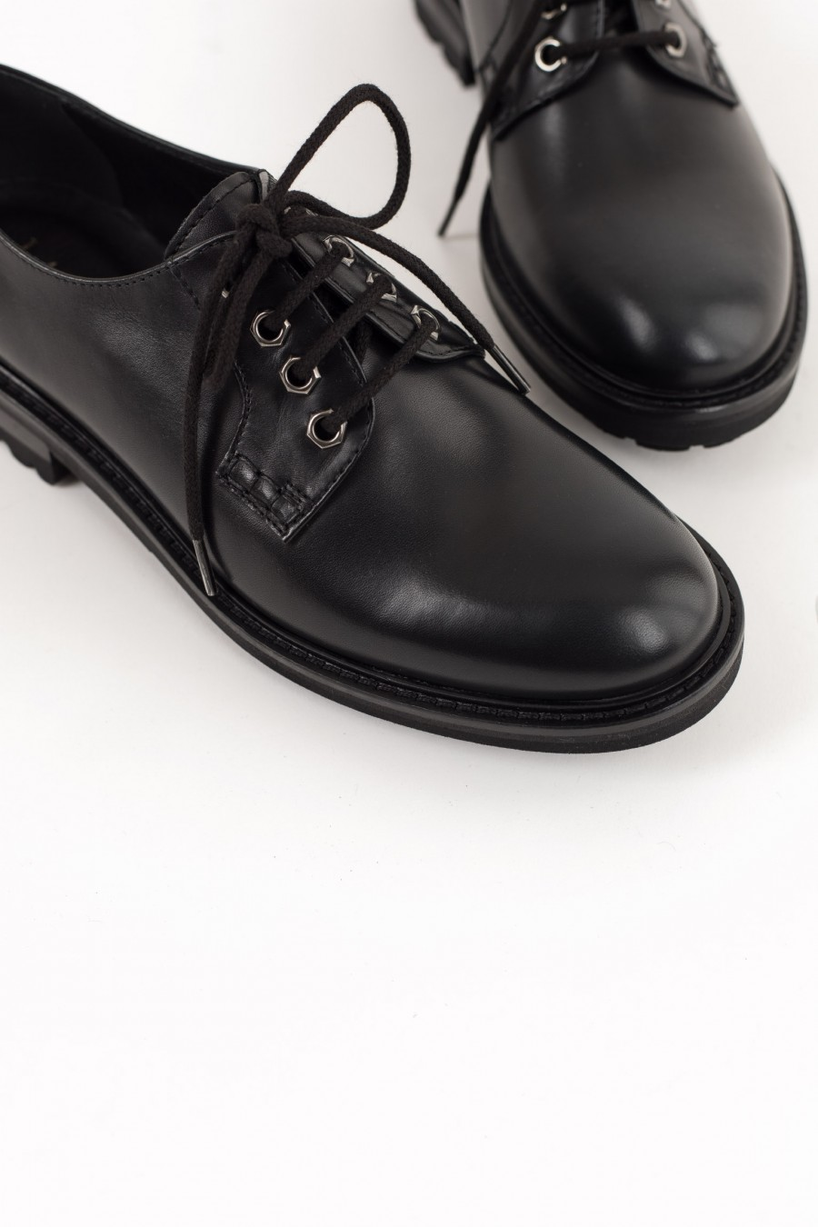 Black rounded toe derby shoes