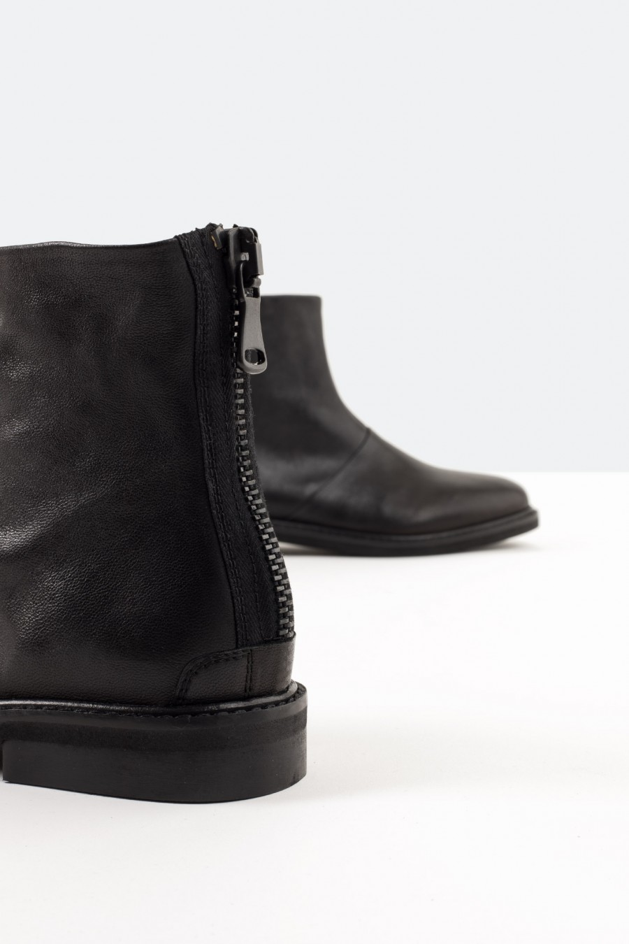 Black leather boots with back zip