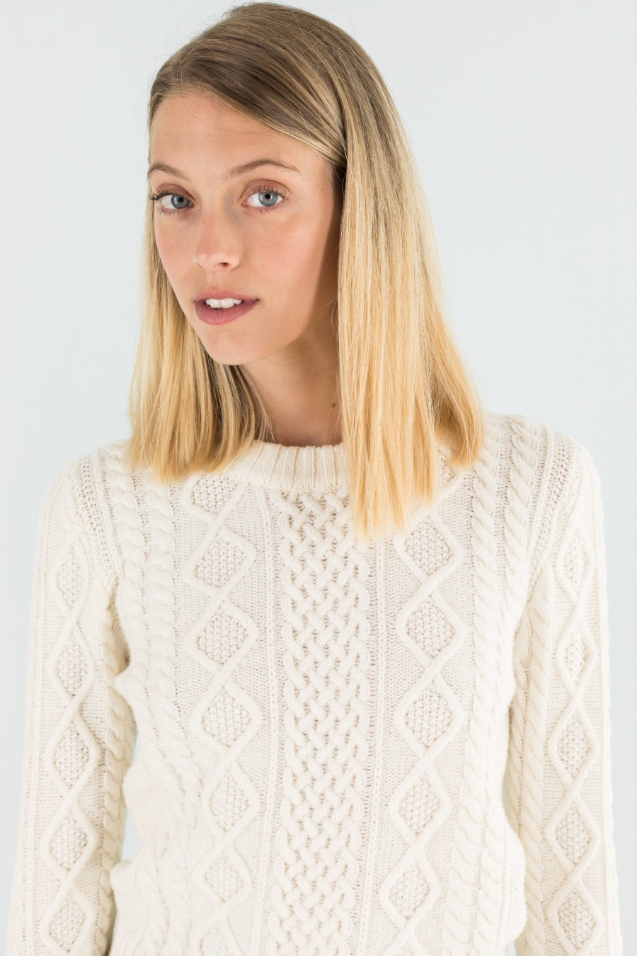 White jumper with woolen braids