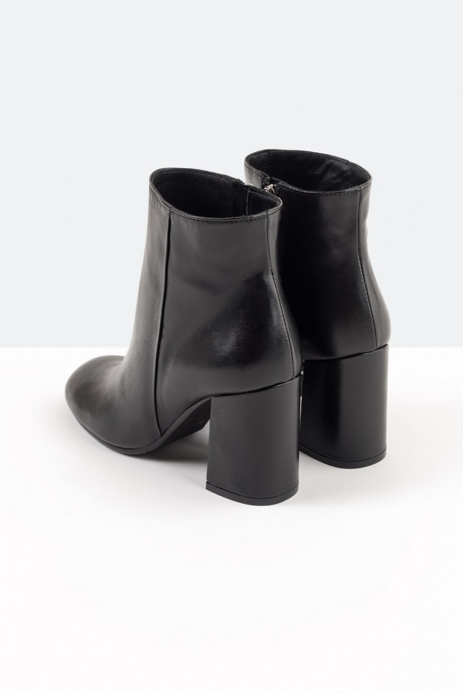 Black leather ankle boots with high heels