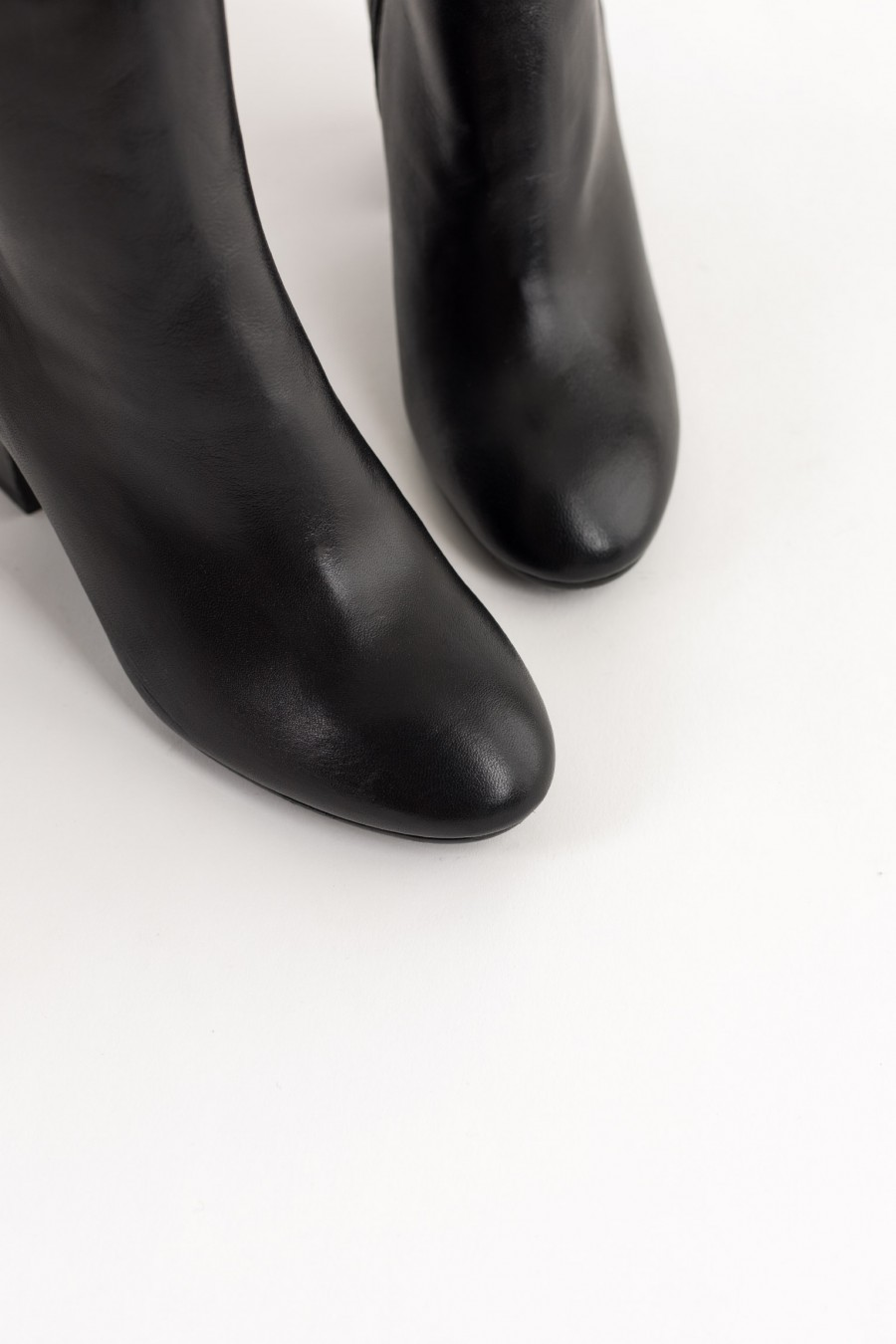 Black leather ankle boots with rounded toe