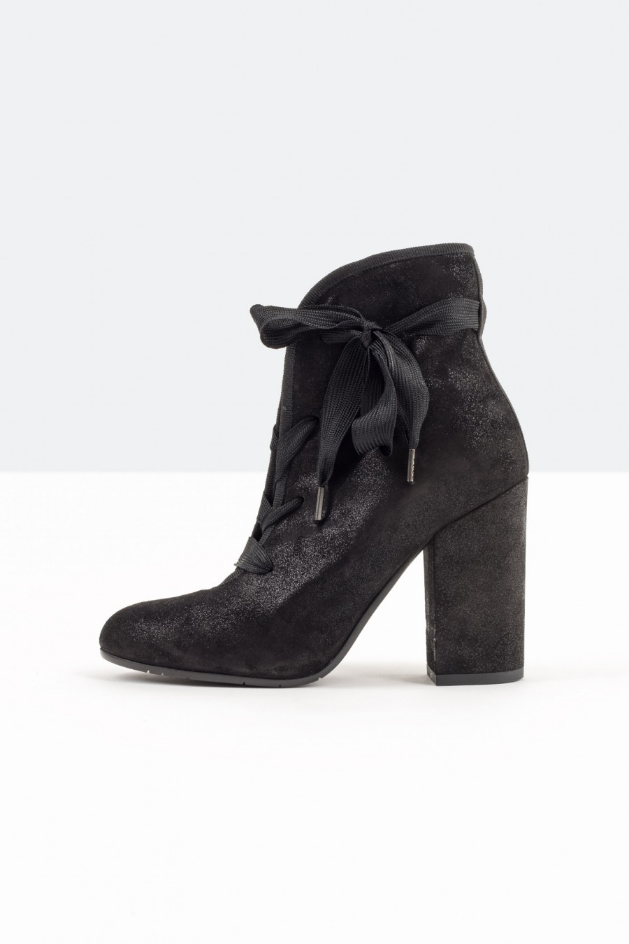 High heeled black boots with laces