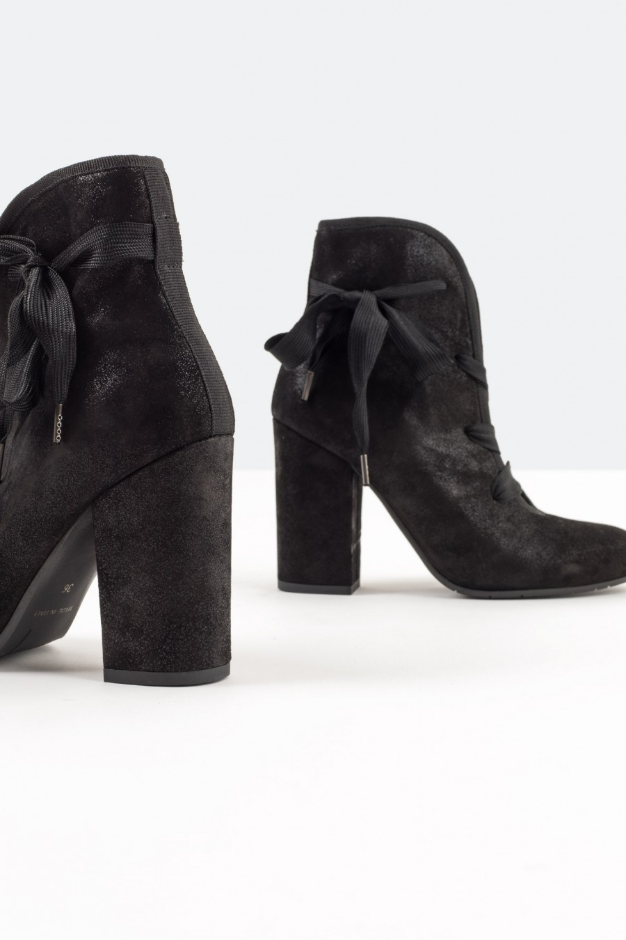 Black metallic leather ankle boots