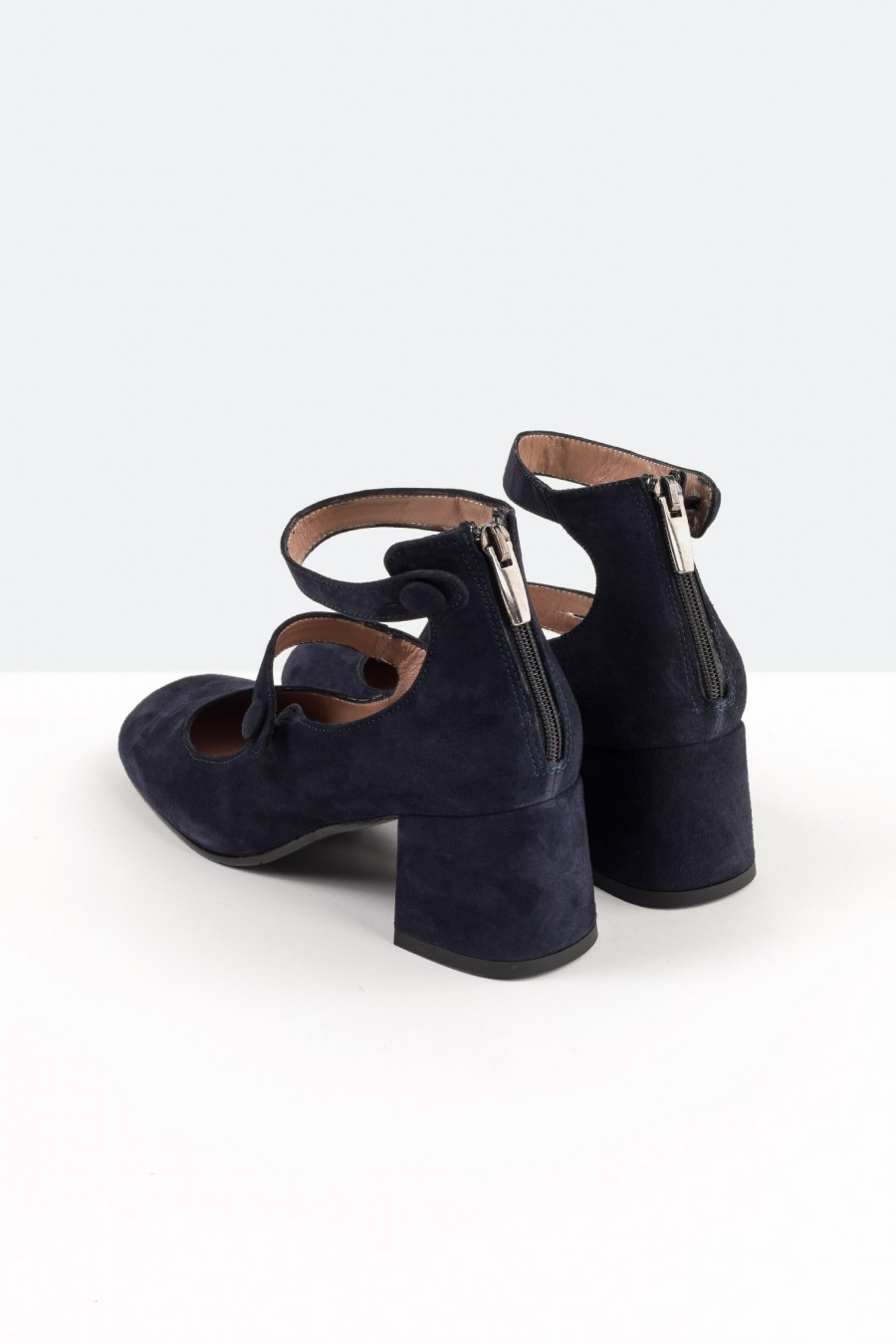 Navy blue suede shoes with ankle straps