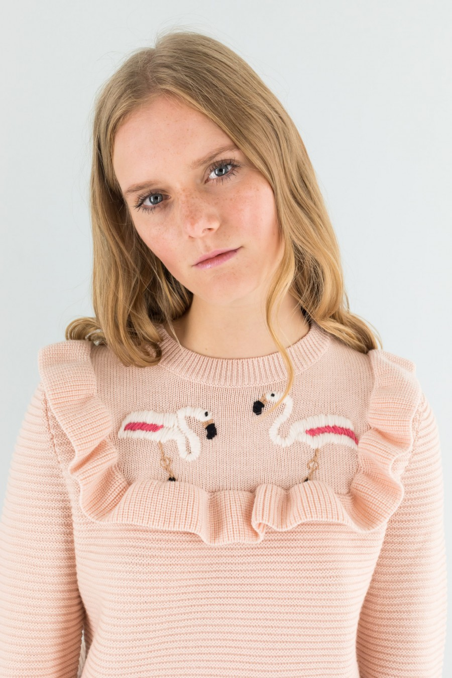 Pink pullover with ruffle