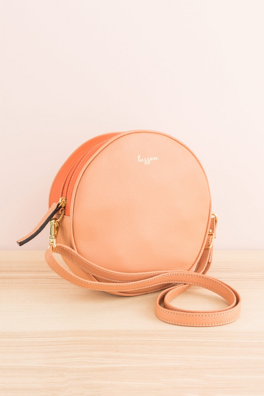 two-tone round bag with shoulder strap and zipper